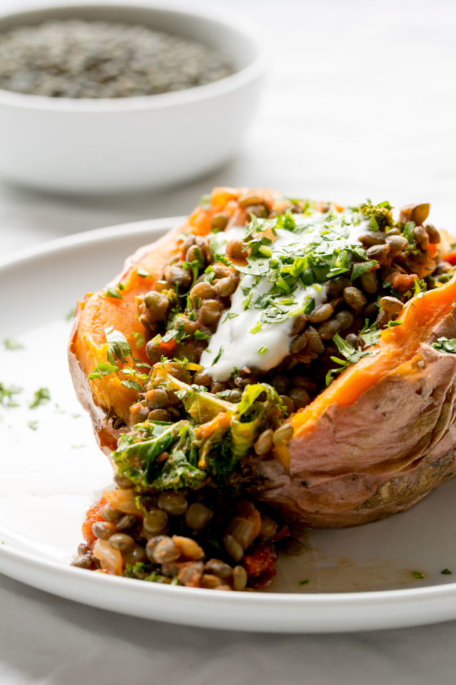 Stuffed Sweet Potatoes with Lentils, Kale and Sun Dried Tomatoes | 21 Recipes to Get Hygge With on CaliGirlCooking.com