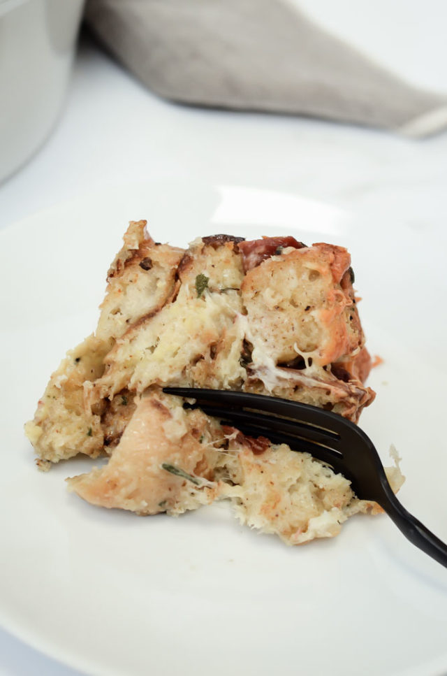 This Savory Prosciutto, Sage and Gruyere Bread Pudding is perfect as a side dish but also filling enough to be the main event. It's the perfect recipe to entertain a crowd!