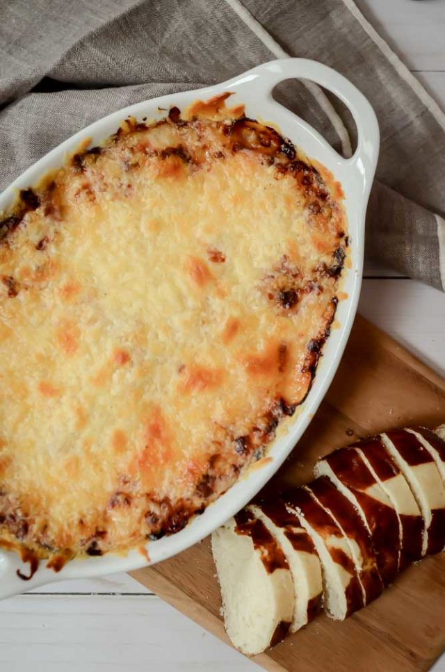 This irresistible Reuben dip is the perfect party snack. It's easy to make and everyone will love it!