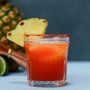 A single Li Hing Pineapple Margarita garnished with a pineapple wedge.