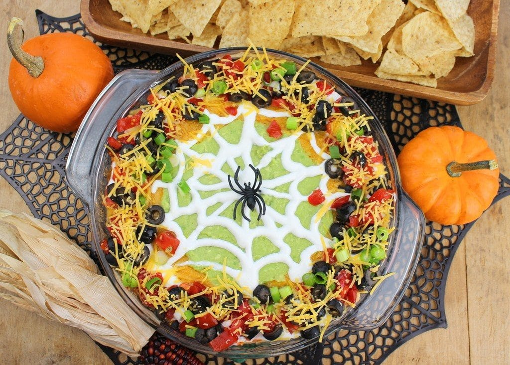 Spider Web Taco Dip by Palatable Pastime | 22 Quick & Easy Halloween Recipes at CaliGirlCooking.com