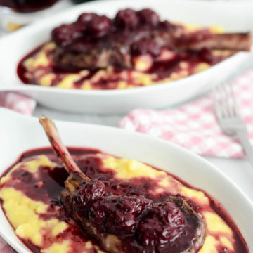 Herb-Crusted Lamb Lollipops with Blackberry Reduction Over Creamy Polenta   A Valentine's Day Wine and Food Pairing Dinner for Two on CaliGirlCooking.com