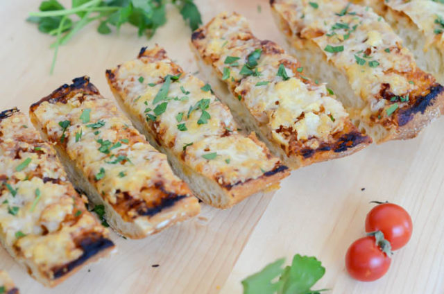 Another close-up of this ooey-gooey delicious Cheesy BBQ Garlic Bread!