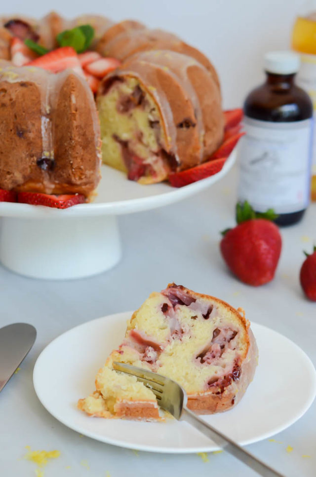 Fresh Strawberry Vanilla Bundt Cake with Lemon Glaze | CaliGirlCooking.com - A slice of this cake and a hot cup of coffee is all you need this Mother's Day!
