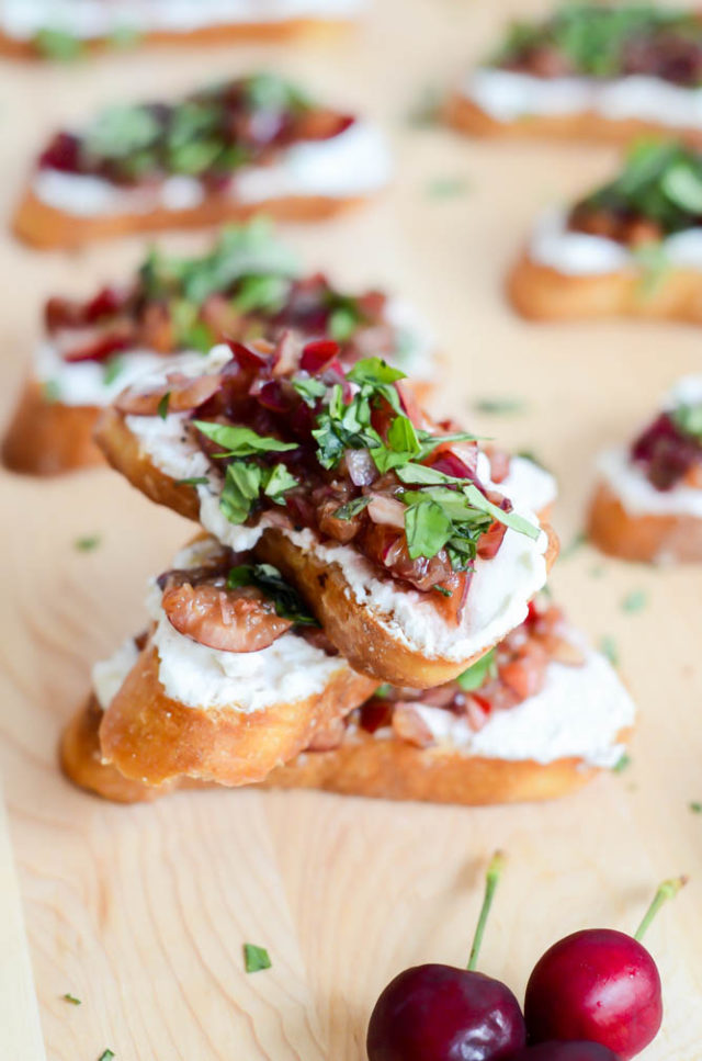 A pile of Herbed Cherry and Ricotta Crostini to make for your next get-together.