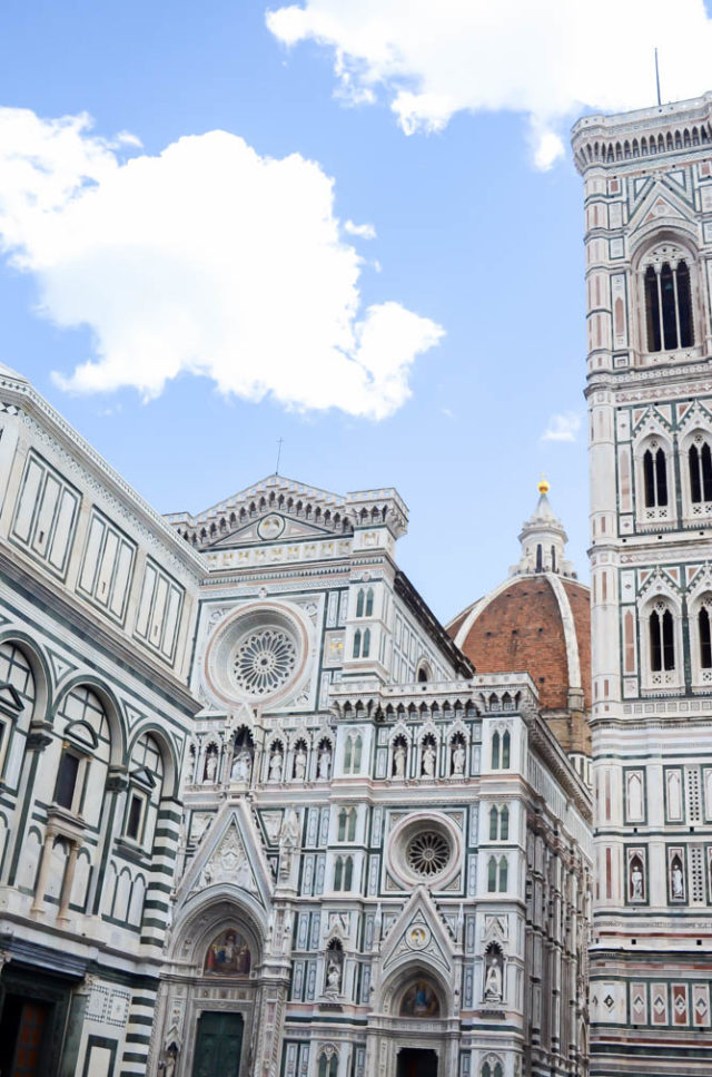 Upwards view of the Duomo and surrounding buildings in Florence.