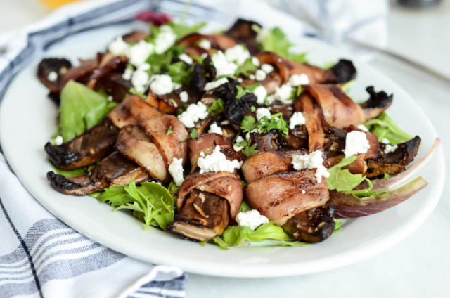 A large plate of Bacon-Wrapped Portobello Mushrooms with Goat Cheese, ready to be enjoyed on Father's Day!