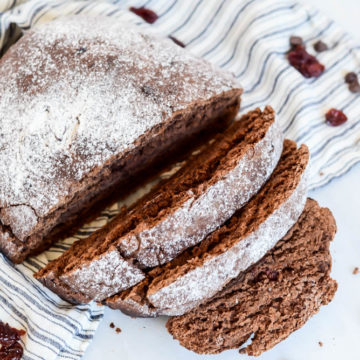 A partially sliced loaf of tasty Chocolate Cherry Bread.