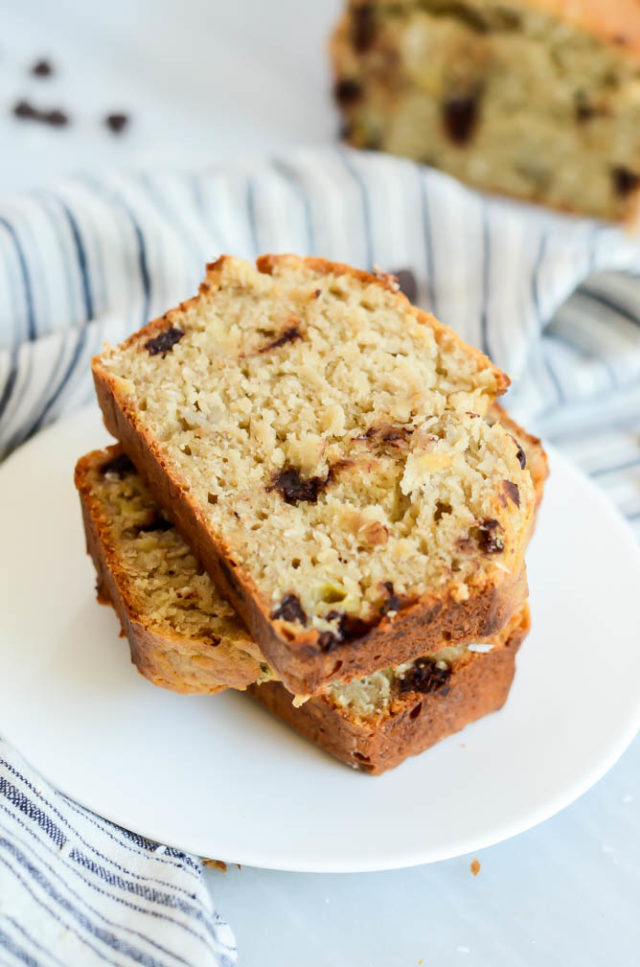Three stacked slices of Coconut Chocolate Chip Banana Bread ready to be eaten!