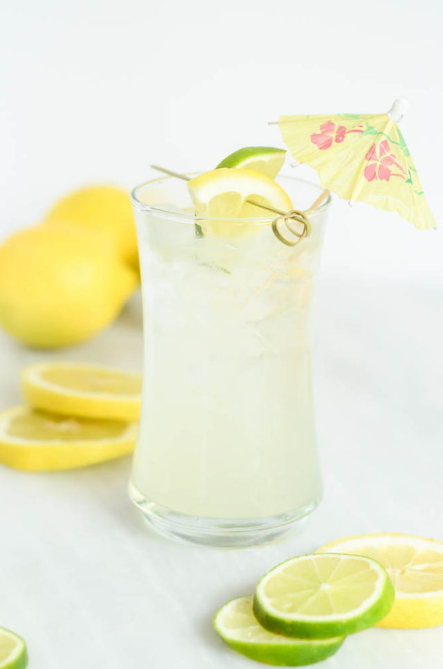 A single ice-cold glass of the Hydrating Citrus Coconut Refresher mocktail or cocktail!