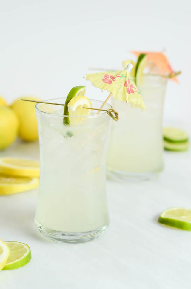 Two frosty glasses of the Hydrating Citrus Coconut Refresher mocktail. You can also make it a cocktail by adding vodka or gin!
