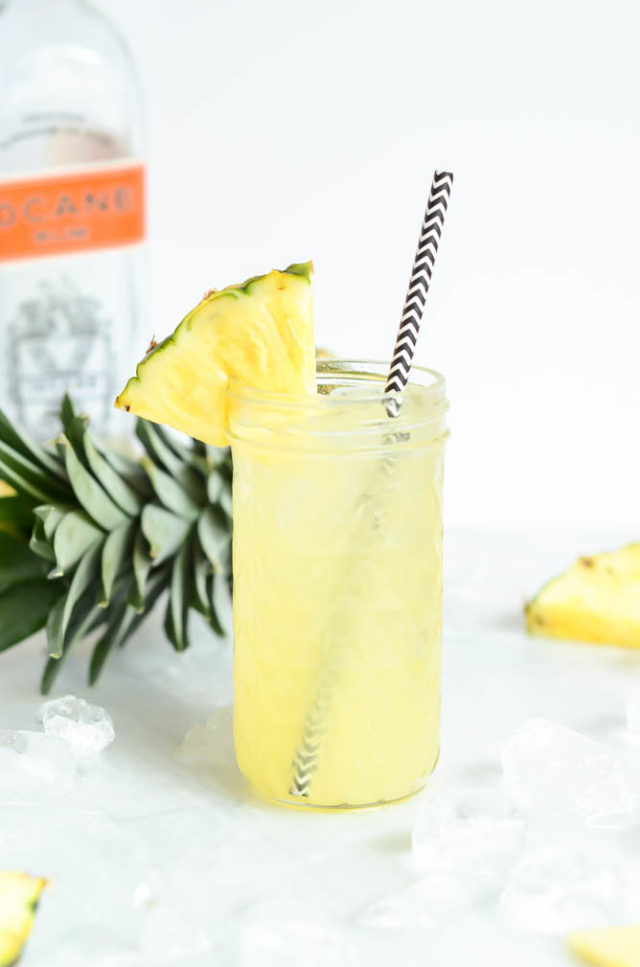 A single glass of the refreshing Pineapple Orgeat Fizz.