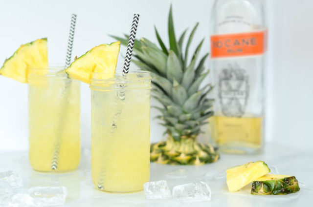 A landscape shot of two icy cold Pineapple Orgeat Fizzes. The perfect cocktail or mocktail for summer!