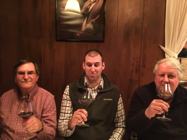 The men enjoying their wine at Ristorante Al Gondolieri, Venice, Italy.