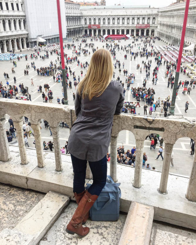 Admiring the view from the Loggia dei Cavalli at the Basilica di San Marco in Venice, Italy.