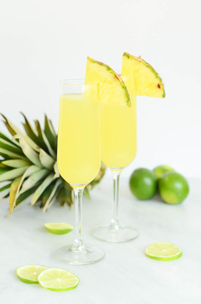 "Two tall flutes of delicious Tropical Pineapple Lime ""Faux-mosas."" The perfect mocktail for any special brunch!"