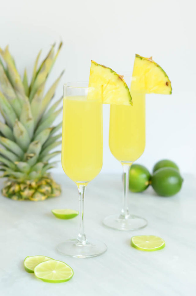 "These Tropical Pineapple Lime ""Faux-mosas"" are the perfect mocktail to serve at your next brunch!"