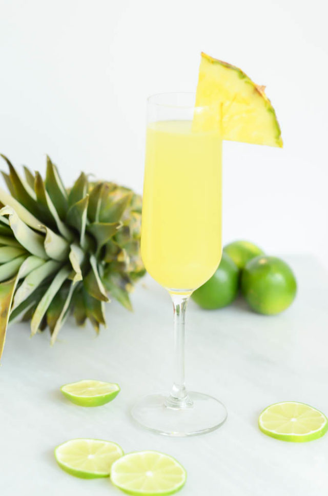 "A single, refreshing glass of a Tropical Pineapple Lime ""Faux-mosa"" for your next special brunch!"