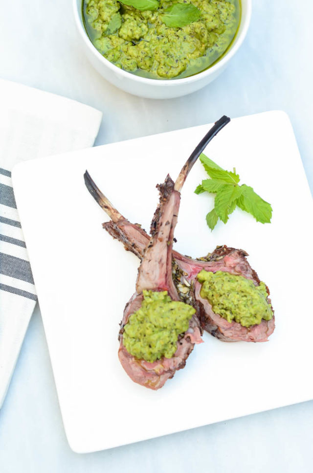 Two beautiful lamb lollipops of Herb Crusted Rack of Lamb with Mint Pea Pesto.