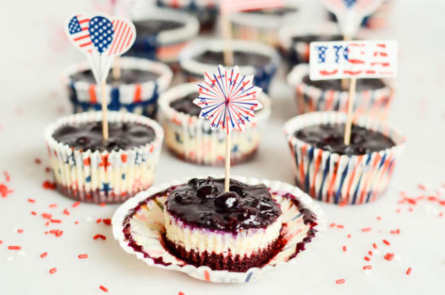 The cupcake wrappers on these Patriotic Cheesecake Bites peel away to reveal red, white and blue layers of deliciousness!
