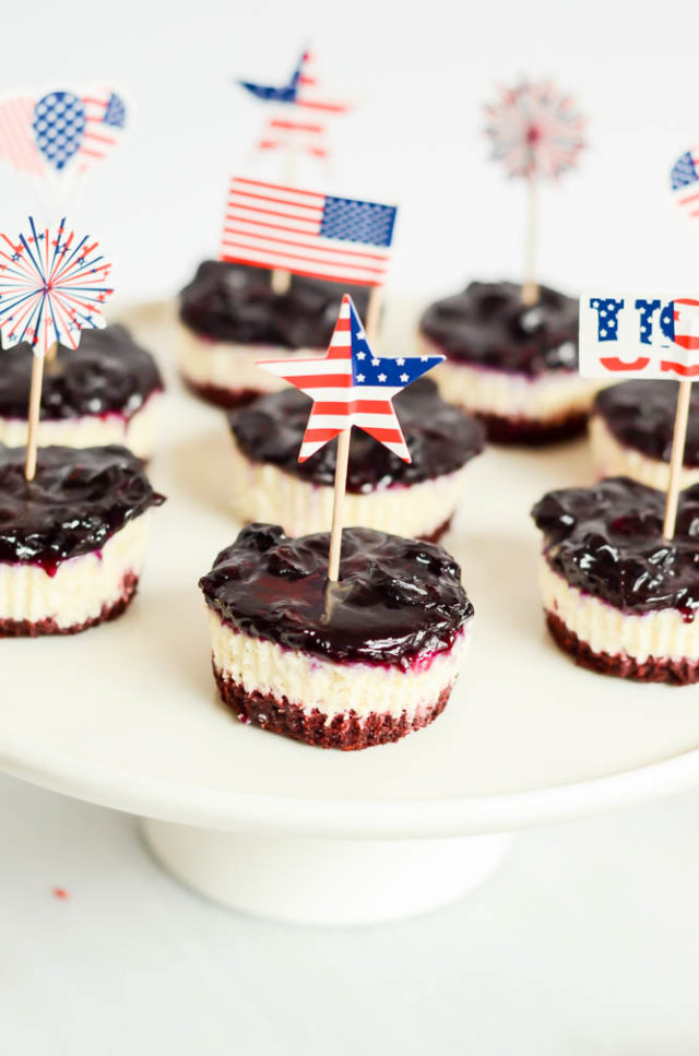These Patriotic Cheesecake Bites feature three layers of red velvet brownie, cheesecake and blueberry compote. The perfect bite-size festive dessert for 4th of July!