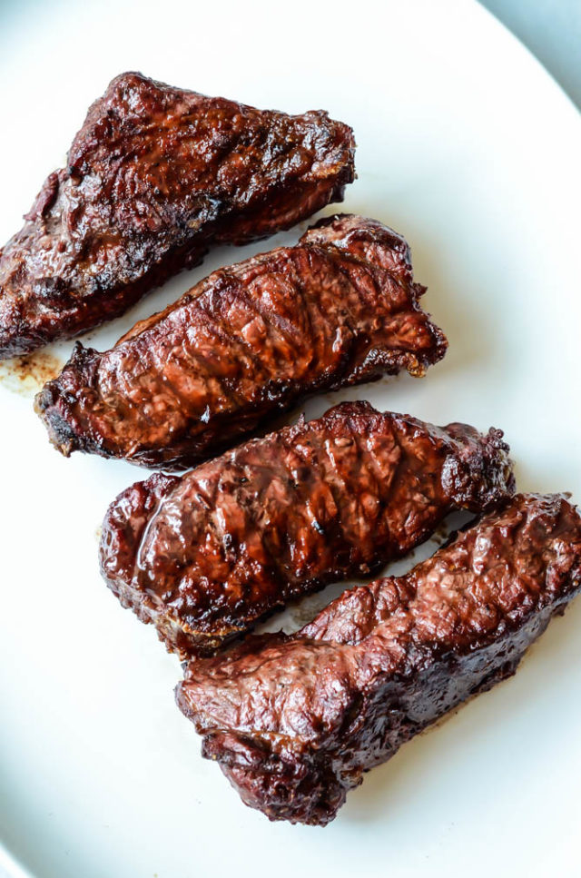 Perfectly cooked sirloin steaks resting before being cut into bite-size pieces and coated in a delicious Bourbon Rosemary BBQ Sauce.