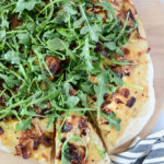This Bacon and Goat Brie Pizza with Vanilla Passion Fruit Jam is delicious fresh out of the oven and topped with fresh arugula.