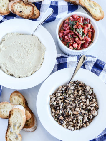 A Bruschetta Bar is perfect for entertaining guests, with tons of options for toppings like Classic Tomato Bruschetta with Mozzarella, Mushroom Bruschetta and Roasted Eggplant White Bean Spread!