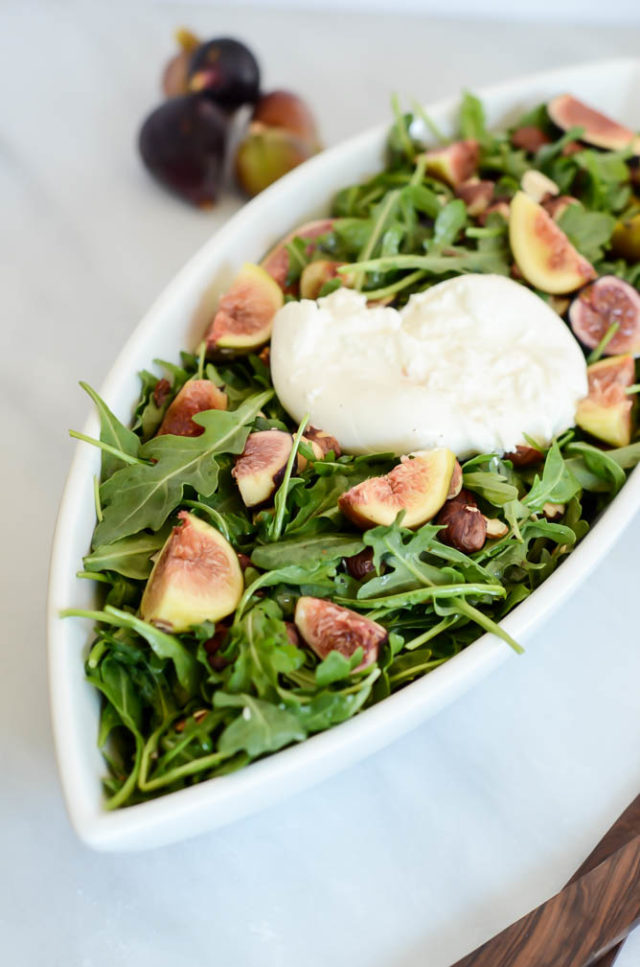 This fresh fig salad features toasted hazelnuts and is topped with creamy, delicious burrata cheese. The perfect summer meal!