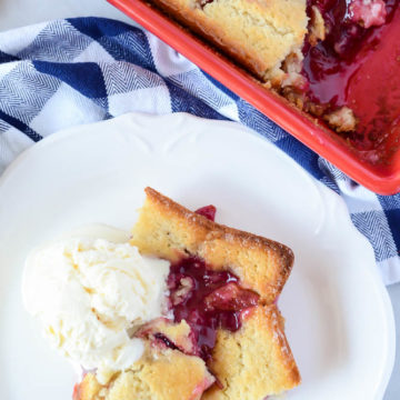 Hot Upside Down Pluot Cobbler fresh out of the oven and topped with a generous scoop of vanilla ice cream.