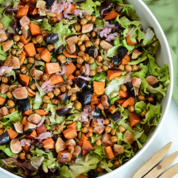 This Fall Harvest Chopped Salad with Apple Cider Vinaigrette is the perfect healthy meal for fall, featuring loads of fresh produce and savory pumpkin spice roasted chickpeas!