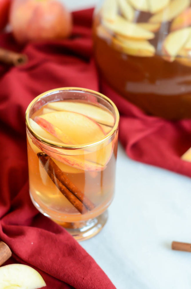 A warm glass of From-Scratch Slow Cooker Spiced Apple Cider is all you need on a cool fall day.