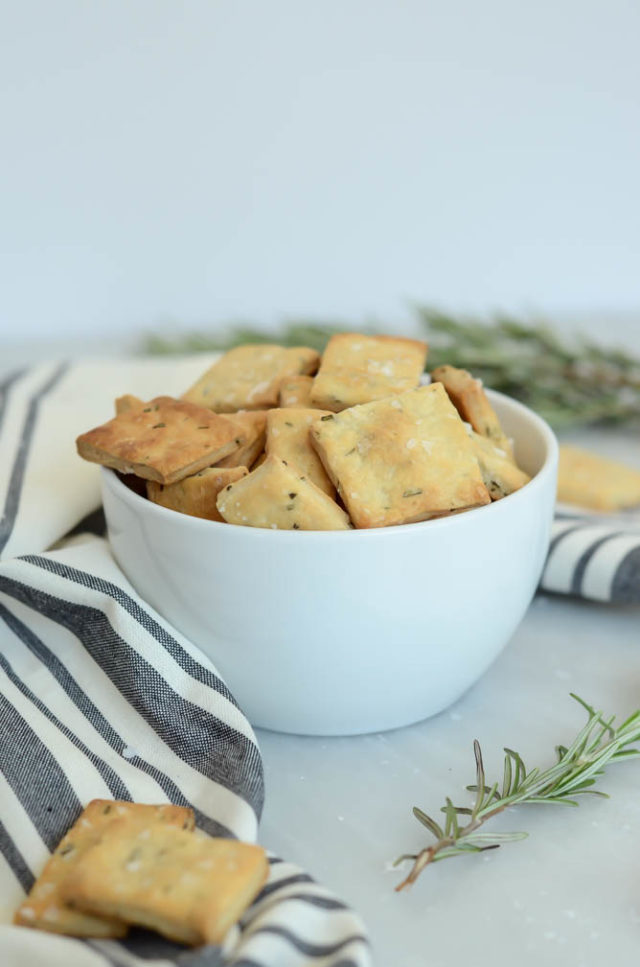 A bowl of Homemade Rosemary and Olive Oil Crackers.