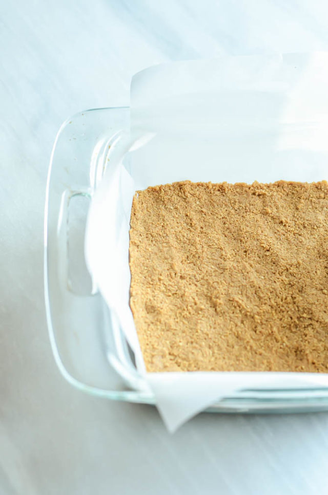 The first step to Peanut Butter and Jelly Cheesecake Bars: a peanut butter-graham cracker crust!