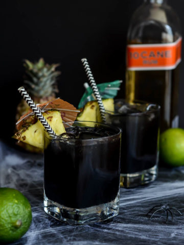 This Midnight Mai Tai features a spooky twist on the classic tiki drink with the addition of activated charcoal.