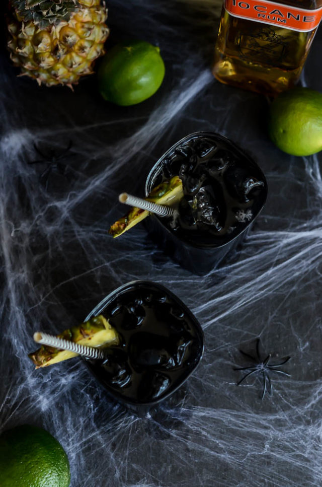 Midnight Mai Tais use activated charcoal to give them their inky black color, perfect for Halloween!