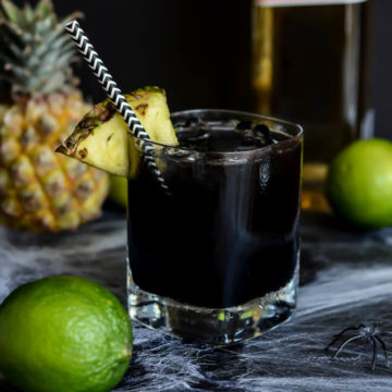 A Midnight Mai Tai is the perfect spooky cocktail to kick off the weekend.