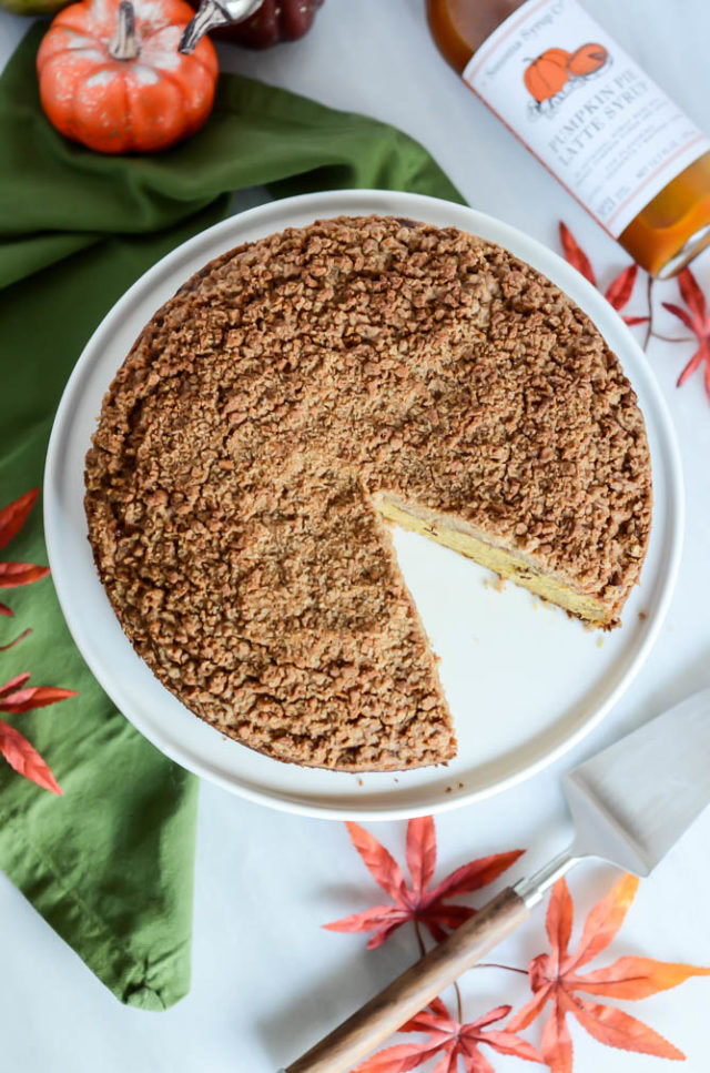 Pumpkin Spice Coffee Cake with Amaretti Crumble with a big slice cut out of it.
