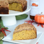 A slice of Pumpkin Spice Coffee Cake with Amaretti Crumble showcases the density and perfect crumb of this delicious fall-themed treat.