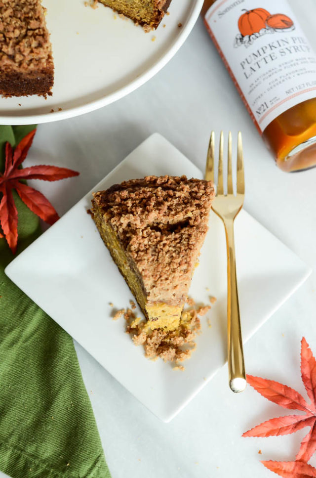 A wedge of Pumpkin Spice Coffee Cake on a white plate.