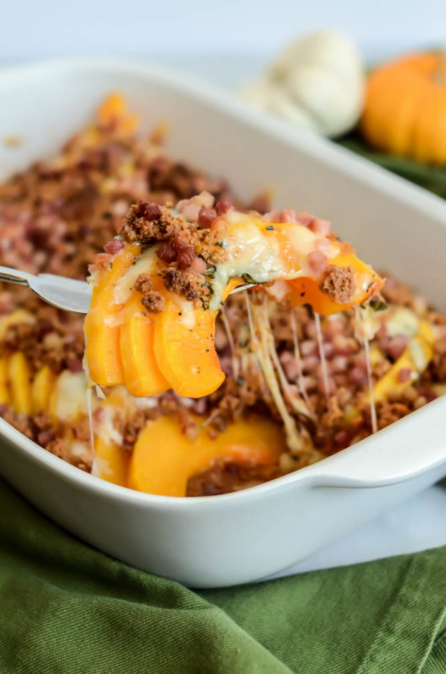 A hefty serving of Herbed Butternut Squash Gratin with Amaretti Crumble is the perfect addition to a holiday meal.