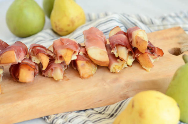Delicious roasted Prosciutto-Wrapped Pears with Creamy Blue Cheese ready to be enjoyed as a holiday appetizer.