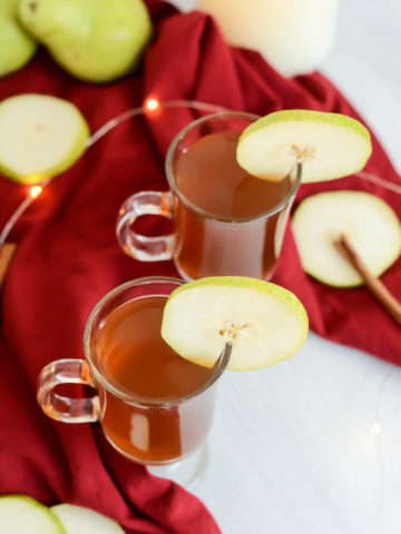 This Spiked Pear Cider is made in the slow cooker and can easily be made virgin for kids to enjoy!