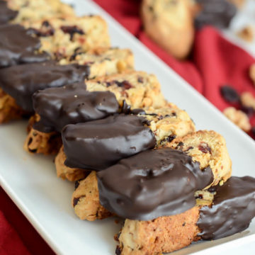 These Chocolate Dipped Cranberry Walnut Biscotti are fantastic dipped in coffee or a hot toddy!