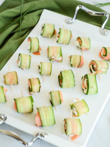 A tray of Five-Ingredient Smoked Salmon and Cucumber Roll-Ups will be a huge hit at your next holiday party!