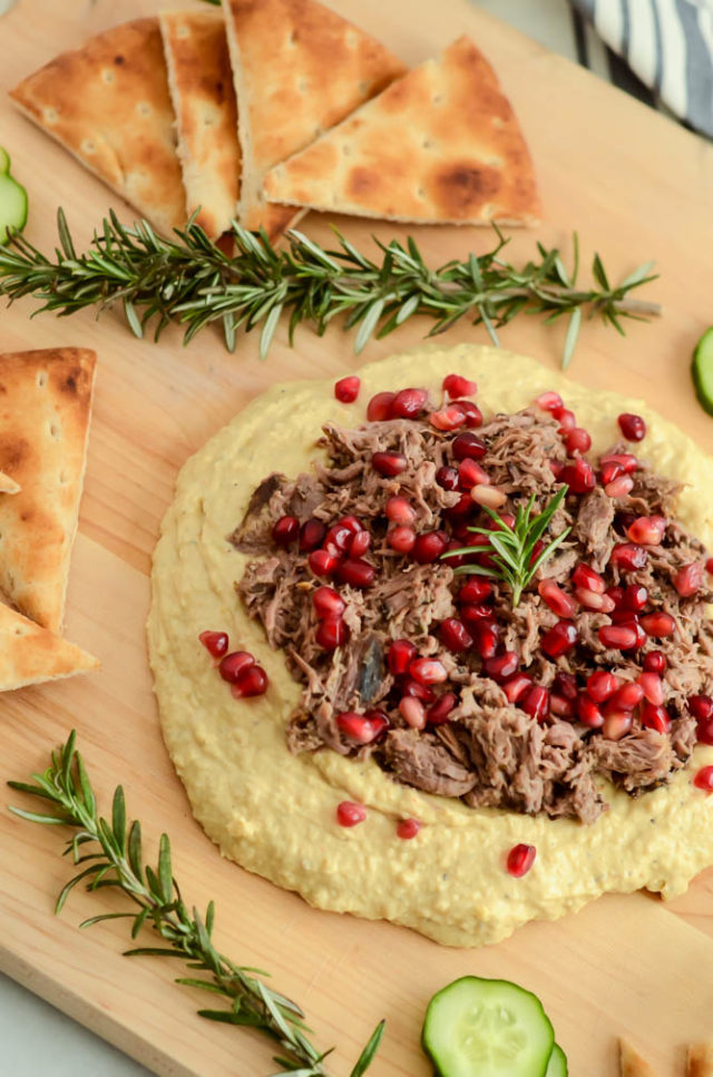 This hummus is loaded with all your favorite Mediterranean flavors from a juicy pulled lamb to refreshing pomegranate seeds.