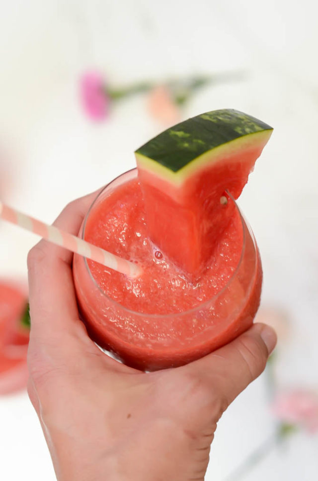 A frosty glass of THE MOST Refreshing Watermelon Aperol Frozé is the only cocktail you'll need all summer!