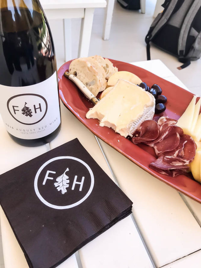 Folded Hills' August Red Wine pairs perfectly with a plate of cheese and charcuterie.