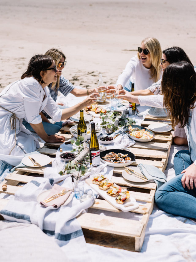 A picture perfect summer beach picnic with seafood, pie, wine and great friends!