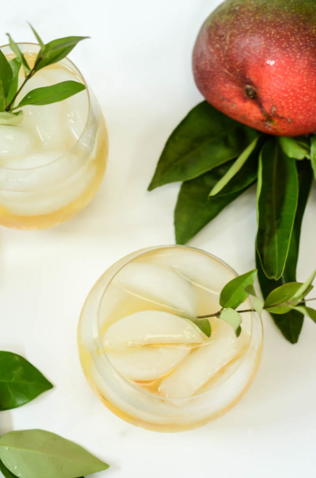 A glass of refreshing, boozy Tropical Sangria is just the cocktail you need for your next party.